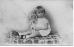 Maureen as infant with doll.jpg